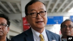 In this photo taken on Nov. 14, 2019, Cambodia's exiled opposition leader Sam Rainsy talks to the media upon arrival at Soekarno-Hatta International Airport in Tangerang, Indonesia.