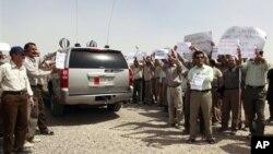 지난 해 9월, 이라크 바그다드에서 시위중인 이란 반체제단체 무자헤딘 할크. (자료사진)