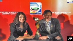 Former U.S. player Mia Hamm (left) and 2011 FIFA Women's World Cup Germany Organizing Committee President and former player Steffi Jones