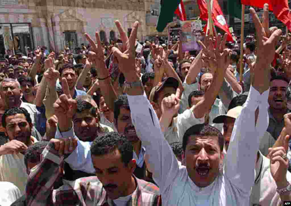 Jordanian and Palestinian protesters flash victory signs as they shout slogans against Israel and the US during a sit-in in front of al-Husseini Mosque in downtown Amman, Jordan, Friday May 21, 2004. Around 1,000 worshippers representing opposition parti