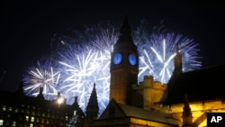 Fireworks explode over the River Thames and the Palace of Westminster's Elizabeth Tower, known as Big Ben, as the New Years Day celebrations begins in London, Friday, Jan. 1, 2016.