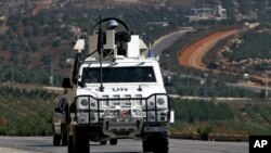 Spanish U.N. peacekeepers patrol the Lebanese Israeli border in the southern village of Odaisa, Lebanon, Aug. 29, 2013.