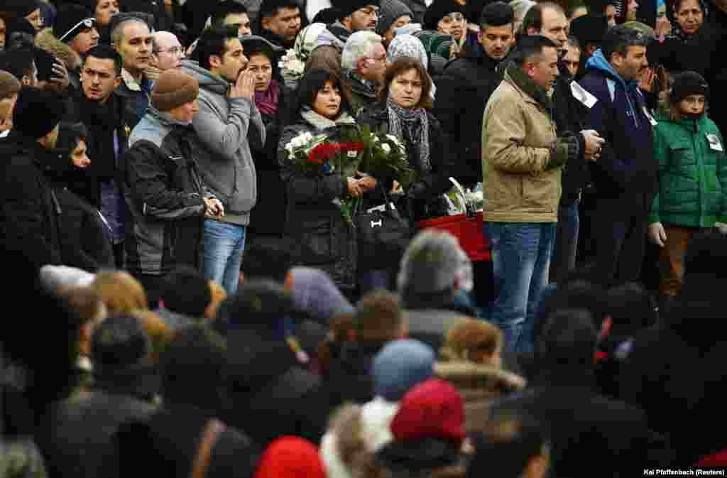 Mourners pray outside a mosque during a memorial service for late student Tugce Albayrak in Waechtersbach, Dec. 3, 2014