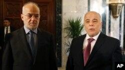 Thủ tướng Iraq Haider al-Abadi (phải) kêu gọi cộng đồng quốc tế làm nhiều hơn nữa để giúp nước ông thắng cuộc chiến chống nhóm Nhà nước Hồi giáo