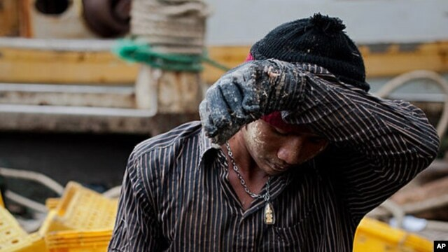 FILE - One of the thousands of men from Myanmar and Cambodia who set sail on Thai fishing boats every day as slaves, forced to work in brutal conditions under threat of death.