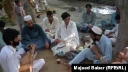 Pakistan -- A file photo of Pakistani men playing rabab at a gathering in Peshawar area, 2001