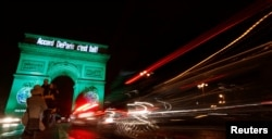 """The Arc de Triomphe is illuminated in green with the words """"Paris Agreement is Done,"""" to celebrate the Paris U.N. COP21 Climate Change agreement in Paris, France, Nov. 4, 2016."""
