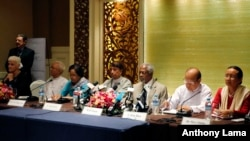 Former U.N. secretary-general and Rakhine State Advisory Commission Chairman Kofi Annan, third right, and commission members listen to journalists posing questions during a press briefing at a hotel Sept. 8, 2016, in Yangon, Myanmar.