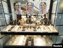 Salesmen are seen in a gold shop in Gold Souq in Dubai, United Arab Emirates, Dec. 30, 2018.