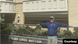 """James """"Jamie"""" Juanillo in front of his home"""