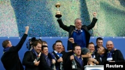 Team Europe captain Paul McGinley (rear) celebrates with players during the closing ceremony of the 40th Ryder Cup at Gleneagles in Scotland Sept. 28, 2014.