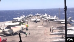 Radar Jet (left) and other jets are pictured on the deck of the USS Ronald Reagan. (Neou Vannarin/VOA Khmer)