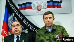 FILE - Alexander Zakharchenko, right, leader of the separatist-controlled area of Donetsk, and Igor Plotnitsky, leader of the separatist-controlled area of Luhansk, attend a news conference in Donetsk, Feb. 2, 2015.