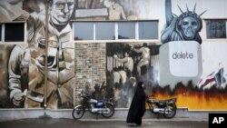 Anti-U.S. graffiti painted on the walls of the former U.S. Embassy in Tehran, Iran, Nov. 2, 2013.
