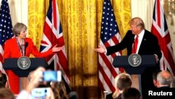 FILE - British Prime Minister Theresa May and U.S. President Donald Trump during their joint news conference at the White House in Washington, Jan. 27, 2017. Both the Trump presidential campaign and the Brexit campaign used Big Data to reach voters. (REUTERS/Kevin Lamarque/Files)