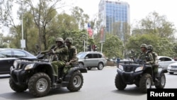 Kenyan police patrol along a main street as the country prepares to receive U.S. President Barack Obama for his three-day state visit, in Kenya's capital Nairobi, July 24, 2015.