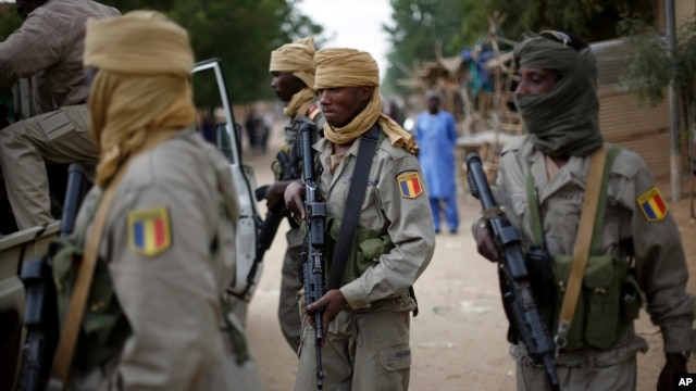 In this picture taken on January 28, 2013, Chadian soldiers patrol the streets of Gao, northern Mali.
