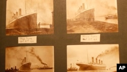 FILE - Photographs of the Titanic are displayed in a family album at the Transport museum in Belfast, Northern Ireland, Oct. 14, 2014.