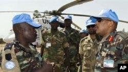 UNAMID Force Commander, Lieutenant General Patrick Nyamvumba (R), visits the Nertiti UNAMID Camp Site in El-Fasher, west Darfur, to get information about an ambush where three Rwandan peacekeepers were killed, 22 Jun 2010