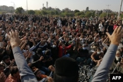 Activists and supporters of Tehreek-e-Labbaik Pakistan (TLP), a religious party, shout slogans during an anti-France demonstration in Islamabad on November 16, 2020.