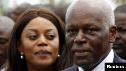 Angola's President Jose Eduardo dos Santos (R) and his wife Ana Paula attend the inauguration of the new Luanda Bay Marginal in the capital Luanda, August 28, 2012.