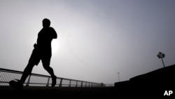 A man runs at Pier A Park in Hoboken, New Jersey, Jan. 15, 2014. (AP Photo)