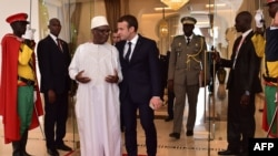 French President Emmanuel Macron, right, walks next to Malian President Ibrahim Boubacar Keita during a G5 Sahel summit, in Bamako, on July 2, 2017, to boost Western backing for a regional anti-jihadist force for the Sahel region amid mounting insecurity and cross-border trafficking.
