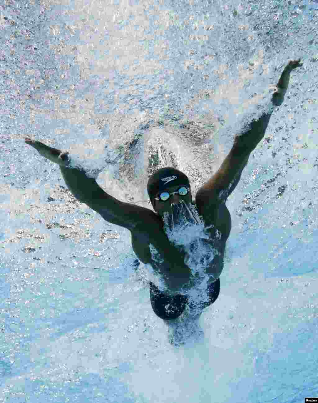 Issa Abdulla Hemed Mohamed of Kenya swims in the men's 100m Butterfly heats during the 2014 Commonwealth Games in Glasgow, Scotland.