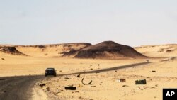 FILE - A car driving along the bandit-plagued road between Sebha and Ubari in southwestern Libya.