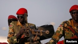 FILE - SPLA soldiers stand in a vehicle in Juba, December 20, 2013.