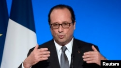 FILE - French President Francois Hollande delivers a speech at the Elysee Palace in Paris, July 23, 2014.