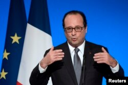 French President Francois Hollande gestures as he delivers a speech at the Elysee Palace in Paris, July 23, 2014.
