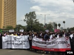 Three police officers have been arrested and another is in custody in connection with the deaths of lawyer Willie Kimani and two other men, which prompted this protest march by lawyers in Nairobi, July 6, 2016. (J. Craig/VOA)