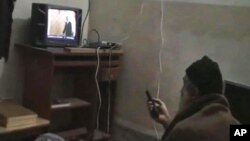 FILE - This undated image from video, seized from the walled compound of al-Qaida leader Osama bin Laden in Abbottabad, Pakistan, and released by the U.S. Department of Defense, May 7, 2011, shows a man, identified as Osama bin Laden, watching then-president Barack Obama on his television.