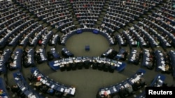 Members of the European Parliament take part in a voting session at the European Parliament in Strasbourg, France, July 3, 2013.
