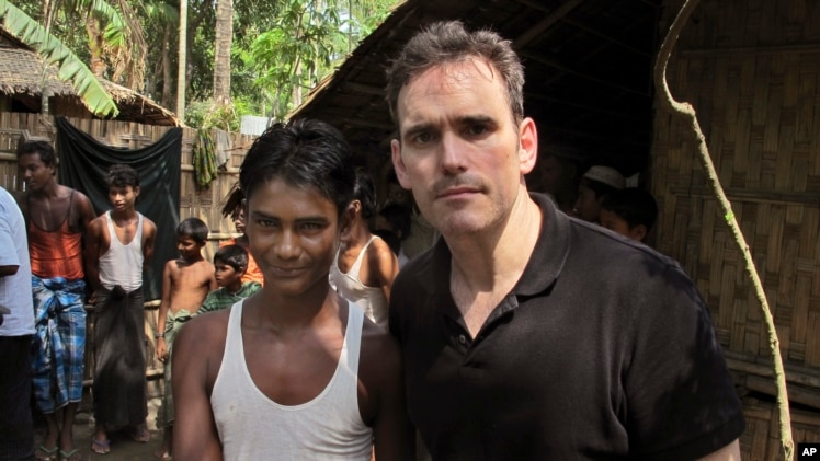 American actor Matt Dillon, right, with Noor Alam, a 17-year old Rohingya survivor of human-trafficking at Thetkabyin village, north of Sittwe in the western state of Rakhine, Myanmar, May 29, 2015.