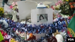 A temporary memorial for Chinese student Lu Lingzi was established in Boston's Copley Square shortly after her death.