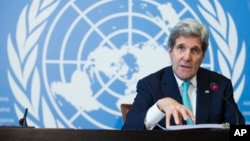 Secretary of State John Kerry gestures during a news conference after he delivered remarks to the United Nations Human Rights Council in Geneva, March 2, 2015.