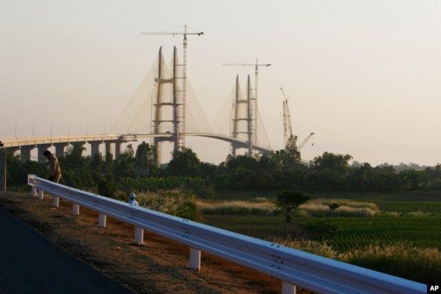 FILE - Cambodia's longest bridge is seen under construction before it is inaugurated in Neak Loeung, southeast of Phnom Penh, Jan. 14, 2015.