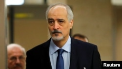 Syria's U.N. ambassador and chief negotiator Bashar al-Ja'afari arrives for a meeting with United Nations Special Envoy for Syria Staffan de Mistura during the Intra Syria talks in Geneva, Switzerland, Dec.1, 2017.