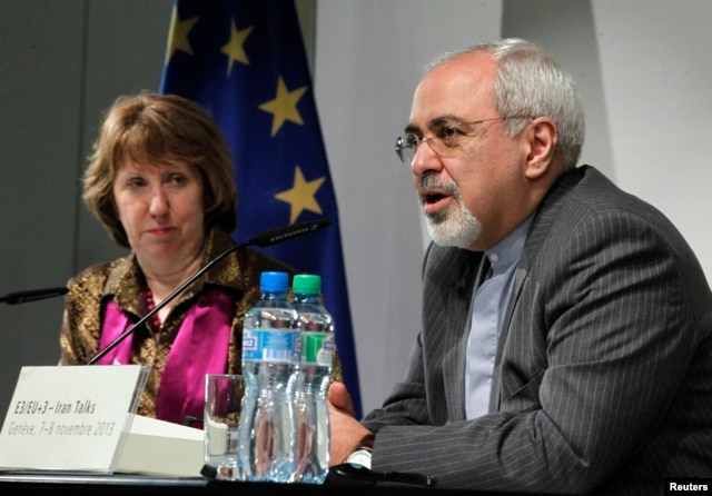 EU foreign policy chief Catherine Ashton listens as Iranian Foreign Minister Mohammad Javad Zarif speaks during a news conference at the end of the Iranian nuclear talks in Geneva, Switzerland, Nov. 10, 2013.