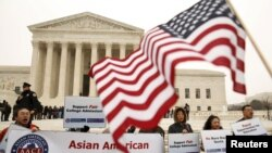Asian-American demonstrators protest outside the Supreme Court as the affirmative action in university admissions case was being heard by the court in Washington, December 9, 2015. REUTERS/Kevin Lamarque