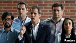 Venezuelan opposition leader Juan Guaido, who many nations have recognized as the country's rightful interim ruler, attends a news conference in Caracas, Venezuela March 21, 2019.