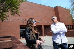 Pat Cronin, right, a director at the Northeast Addictions Treatment Center in Quincy, and Lizabeth Loud, 32, of Randolph, Mass., speak about their experiences of being involuntarily committed for substance abuse treatment, outside District Court in Quincy, Mass., May 7, 2018.