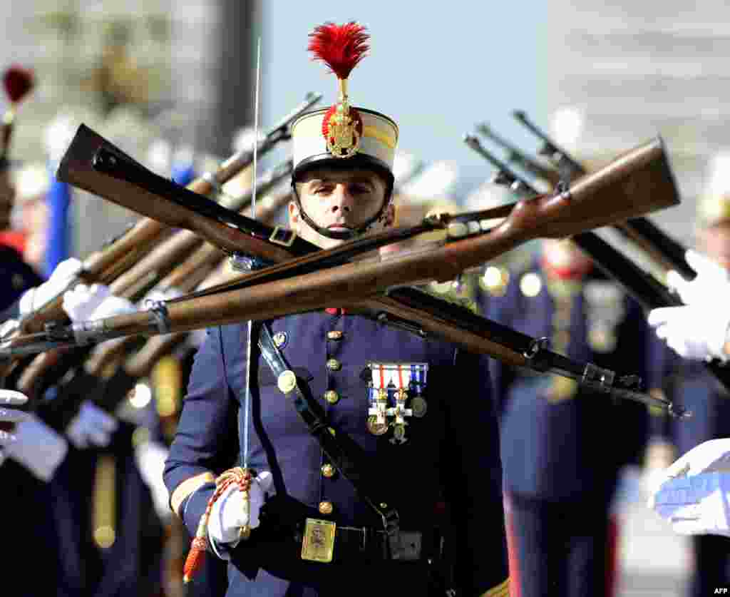 A members of the Spanish Royal Guard marches during the monthly changing of the guard ceremony at the royal palace in Madrid.