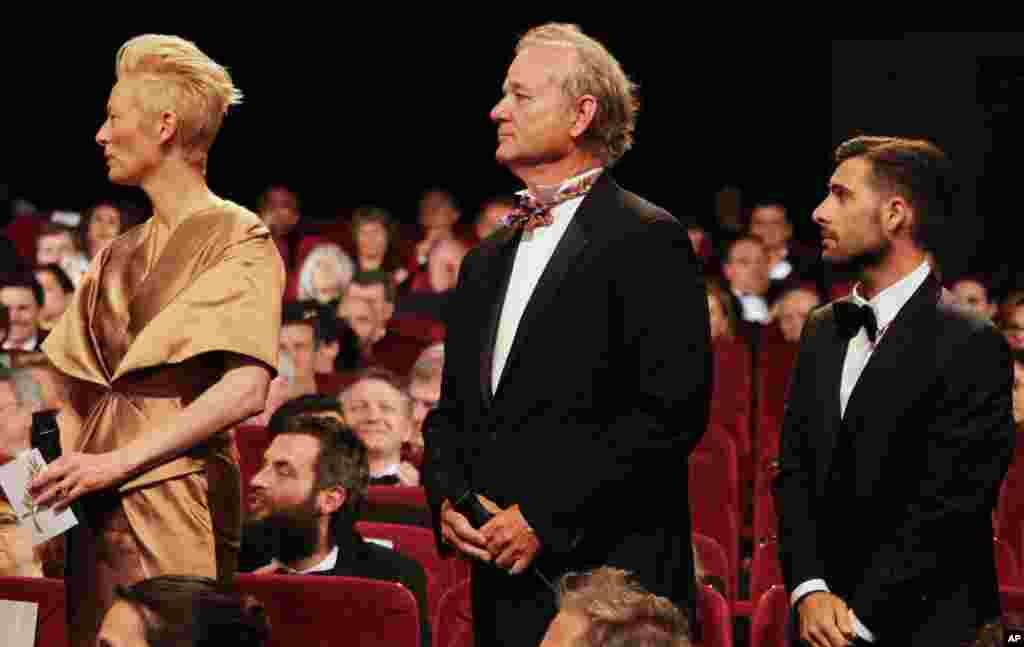 From left, actors Tilda Swinton, Bill Murray and Jason Schwartzman attend the opening ceremony.