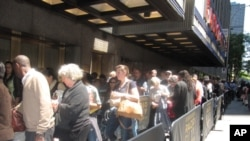 People line up at Radio City Music Hall in New York to hear the Dalai Lama speak.
