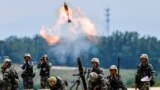 FILE - Soldiers of the Chinese People's Liberation Army fire a mortar during an exercise in Anhui province, China, May 22, 2021.