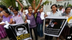 FILE - Sri Lankan women shout slogans during a protest in Colombo, Sri Lanka, Jan. 11, 2013, condemning the execution of Sri Lankan domestic worker Rizana Nafeek in Saudi Arabia. Saudi authorities said Rizana Nafeek has been executed for killing a Saudi baby in her care in 2005.