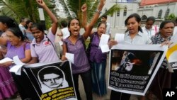FILE - Sri Lankan women shout slogans during a protest in Colombo, Sri Lanka, Jan. 11, 2013, condemning the execution of Sri Lankan domestic worker Rizana Nafeek in Saudi Arabia. (AP Photo/Eranga Jayawardena)